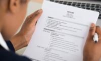 Hiring manager reading candidates resume