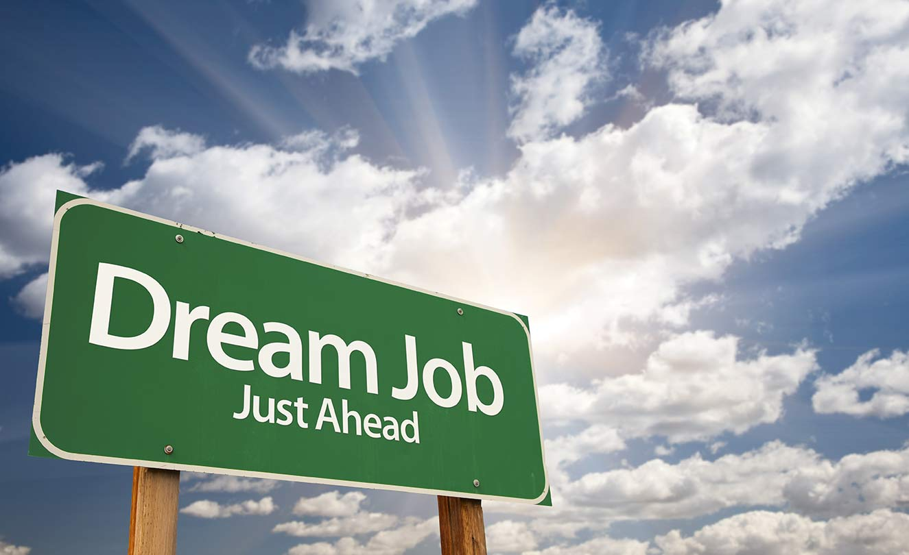 "Green highway sign that states ""Dream Job Just Ahead"""