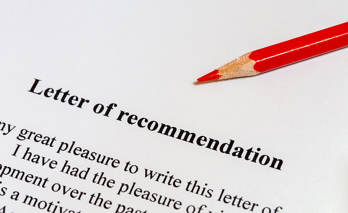A Letter of recommendation with red pencil on top