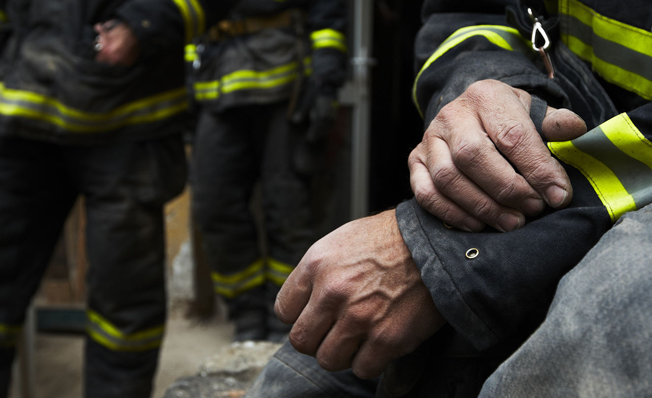 Firefighter sitting contemplating his position