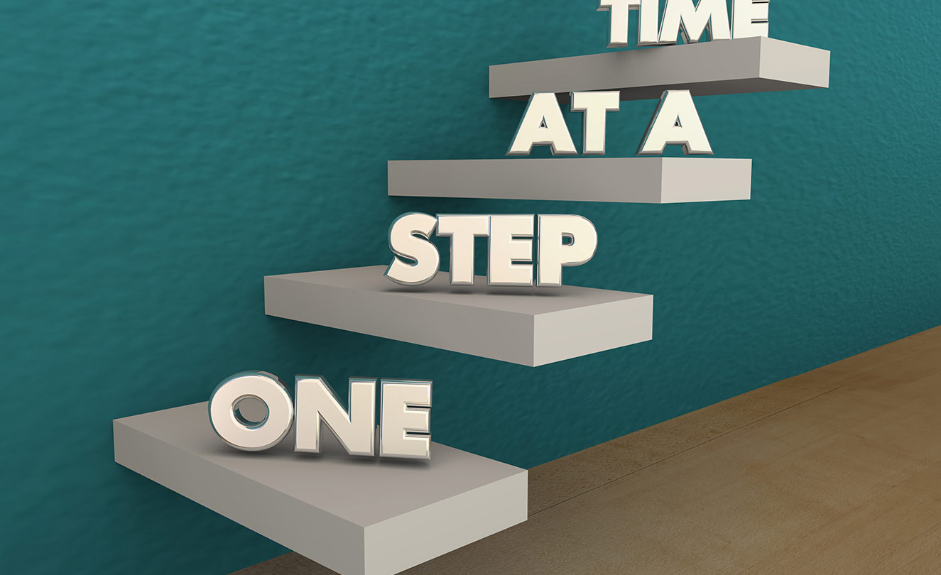 "Staircase with the words ""One Step at a Time""."