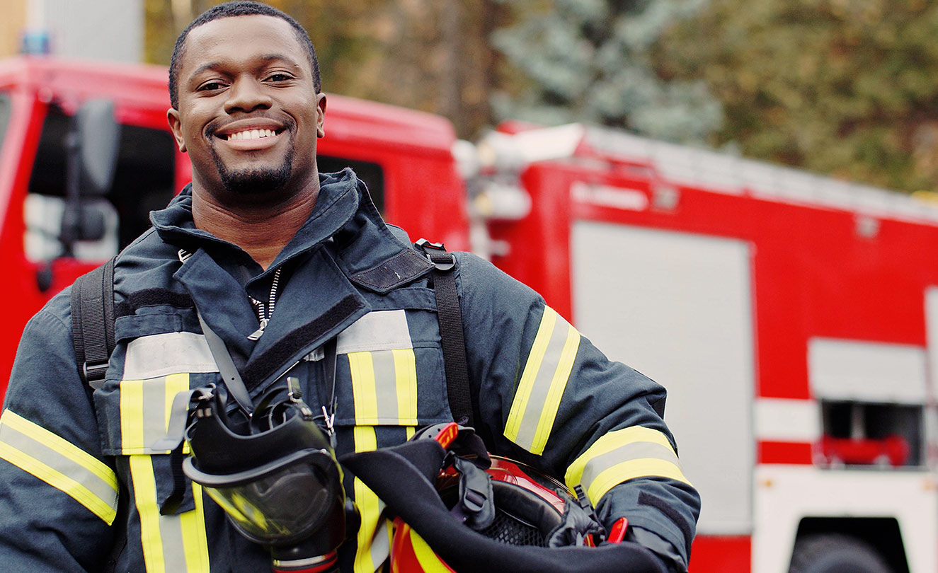 Smiling Firefighter near Fire Truck