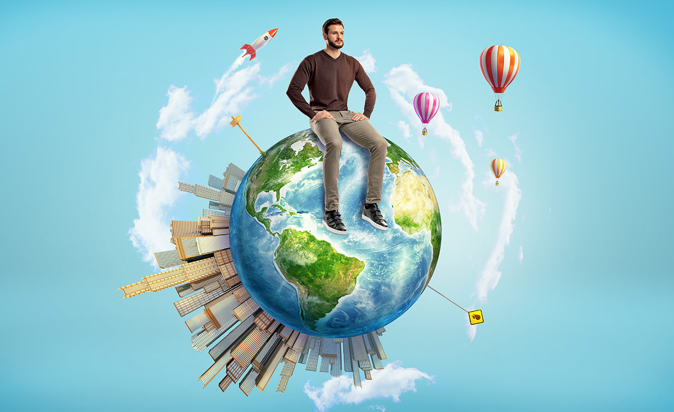 A man sitting on an animated globe with hot air balloons and rockets.